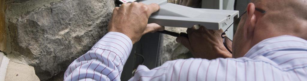 Tech checking breaker box