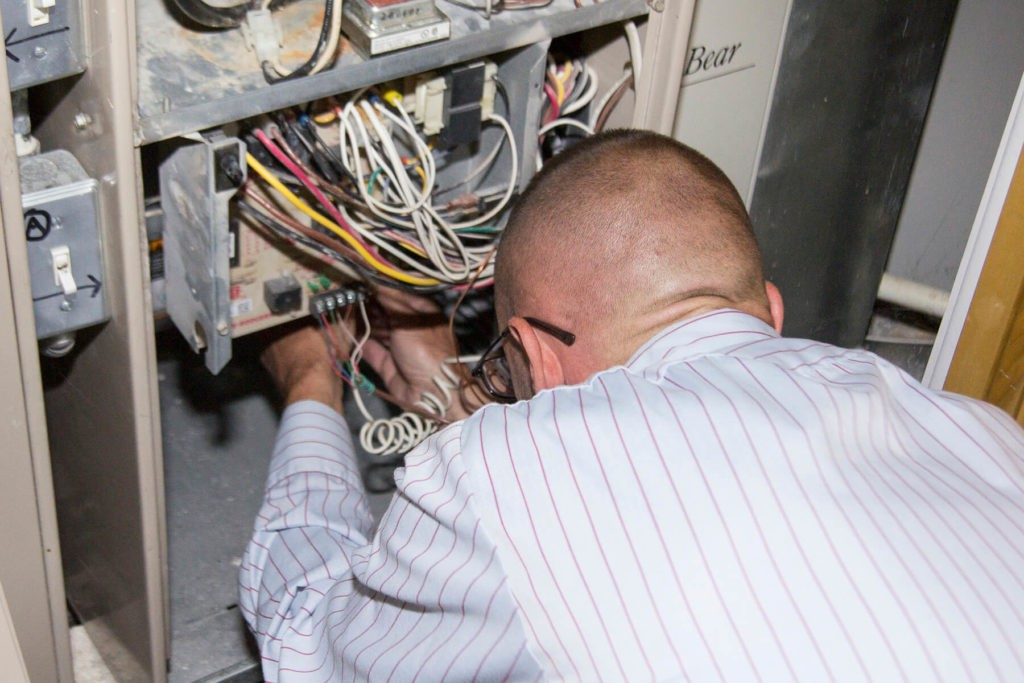 Tech working on electrical